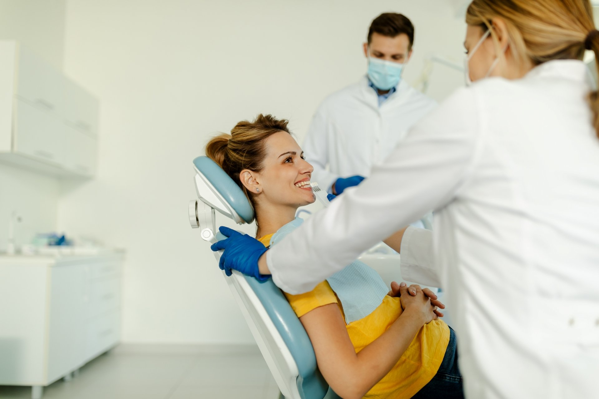 Dentist Talks to Patient about Dental Care
