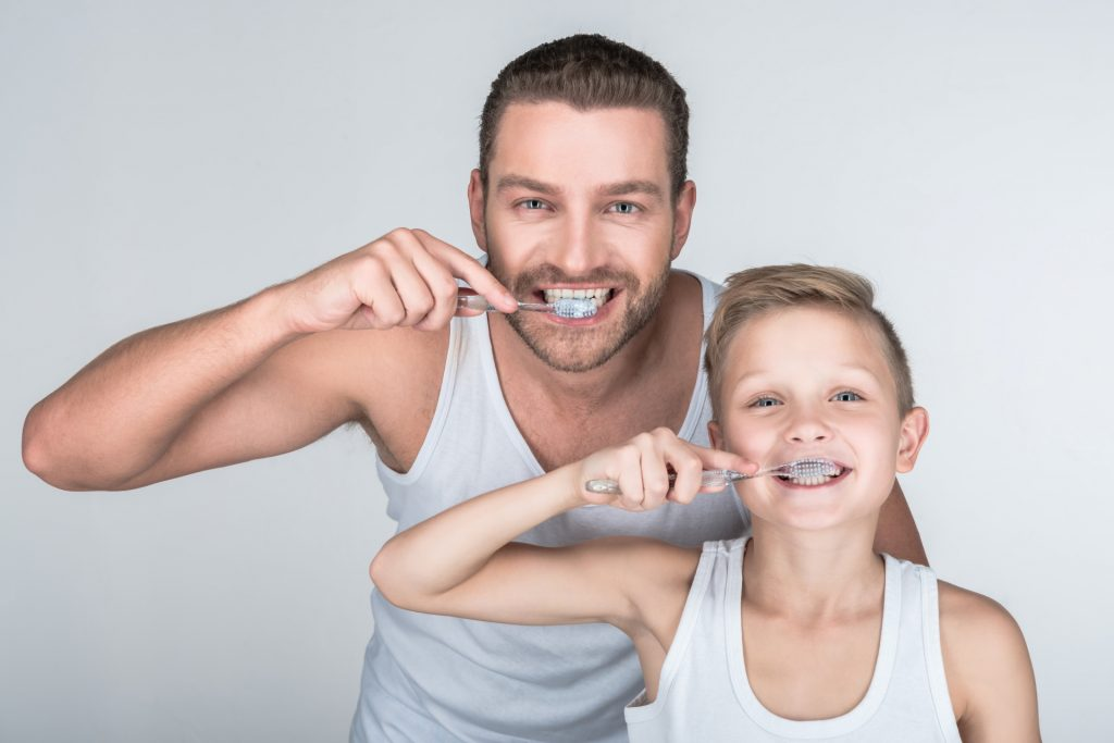 Father and Soon Brushing Teeth Together